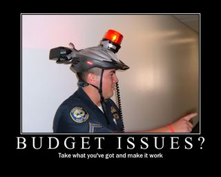 Budget-firefighting-demotivational-poster